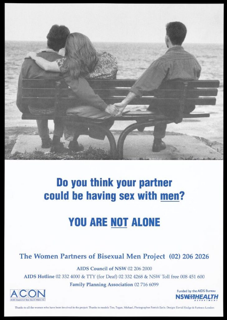 A man sits with a woman on a bench looking out to sea while holding the hand of a man sitting on the end; an advertisement for The Women Partners of Bisexual Men Project