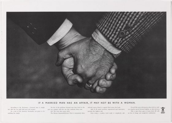 The first HEA 'hands' ad - close-up photo of two white middle class men holding hands