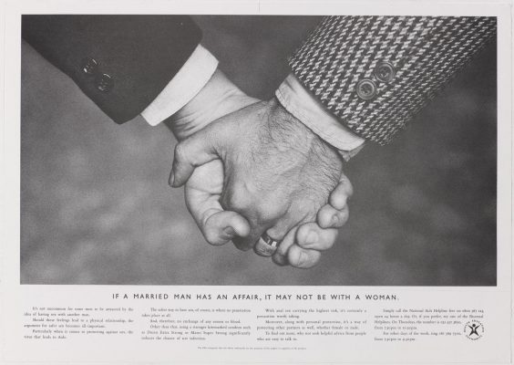 The HEA's 'hands' ad - close up photo of two middle class men holding hands, with the strapline 'If a married man has an affair, it may not be with a woman'